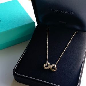 Tiffany & Co. Jewelry - Tiffany white gold infinity necklace with diamonds